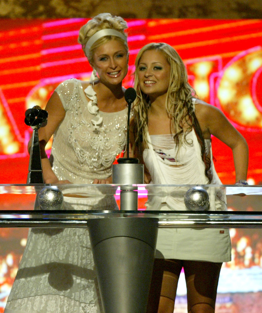 Nicole Richie and Paris Hilton hit the stage together to present at the Billboard Music Awards in December 2003.