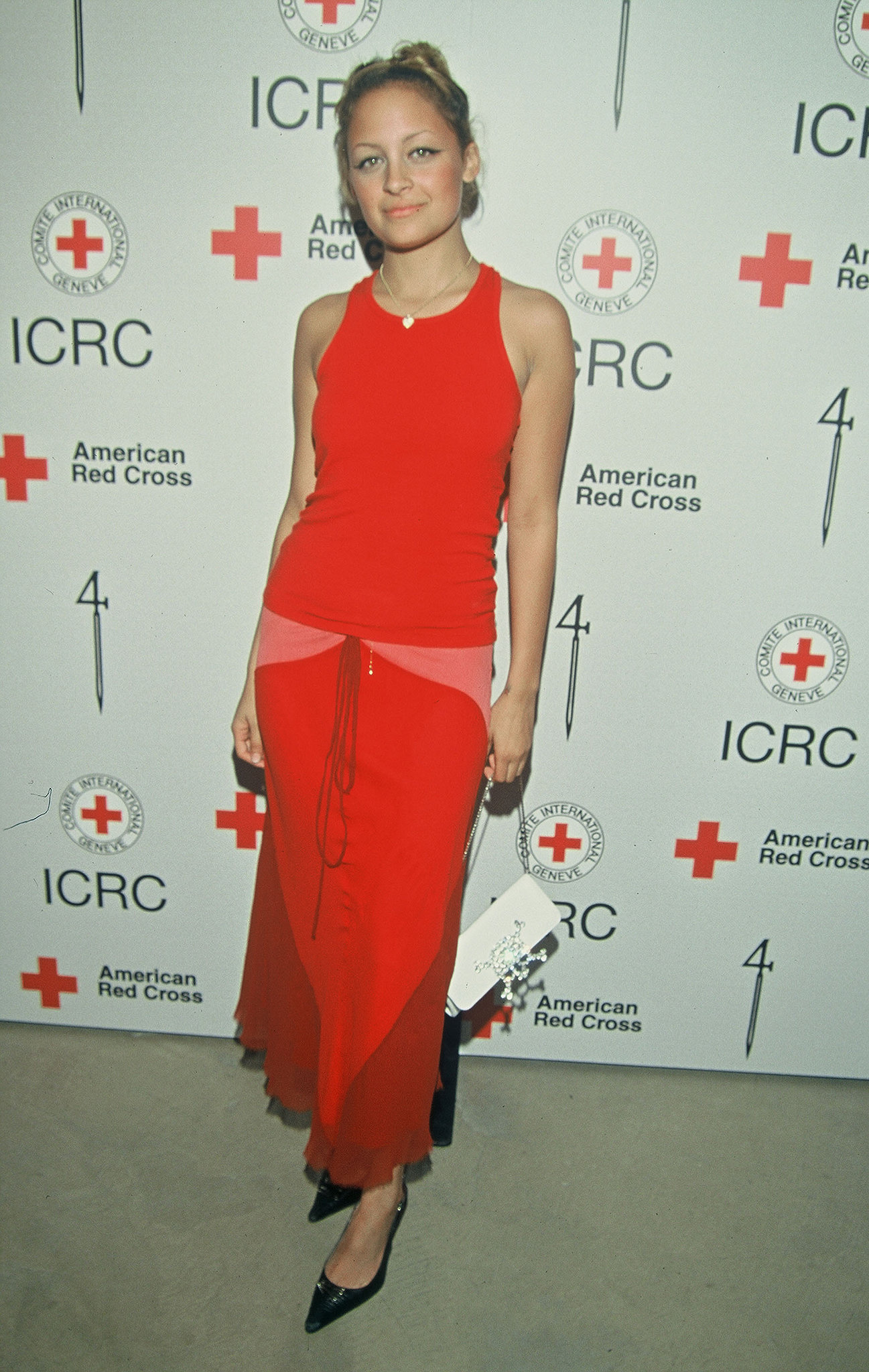 Nicole Richie attended a benefit party in LA in her then-signature brand of brights in March 2002.