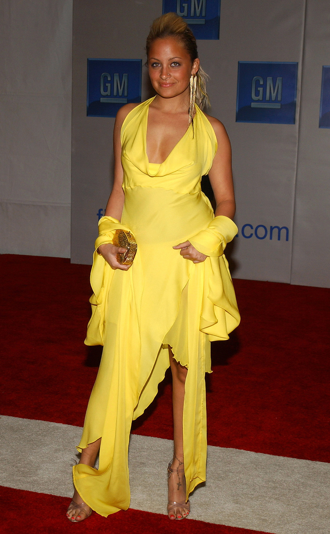 Nicole Richie was anything but mellow in this head-to-toe yellow look at a GM event in Hollywood back in February 2004.