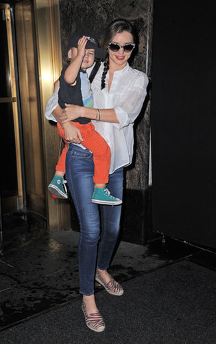 Miranda was stylish while on mommy duty in a white blouse, skinny denim, printed sunglasses, and zebra-print espadrille flats in NYC.