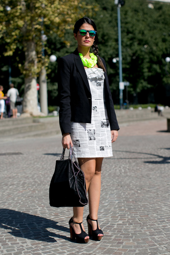 Channeling Carrie Bradshaw in a newspaper print dress.