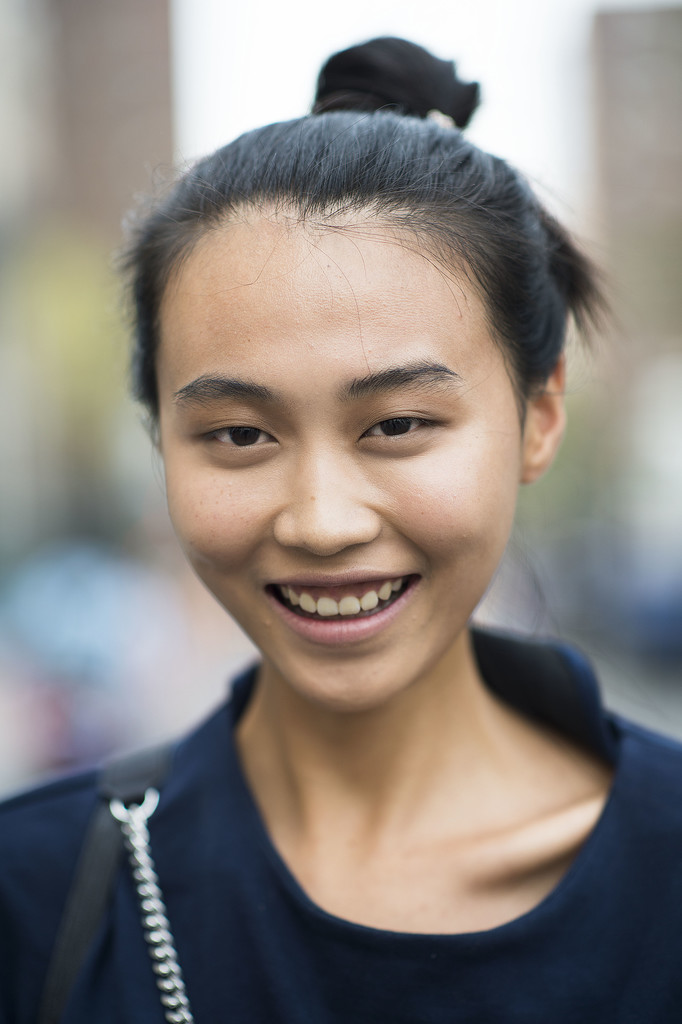 A topknot, bold brows, and a smile make this casual look that much more beautiful. Source: Le 21ème | Adam Katz Sinding