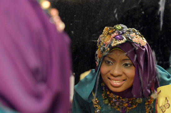 Obabiyi Aishah Ajibola of Nigeria checked her makeup in a mirror.