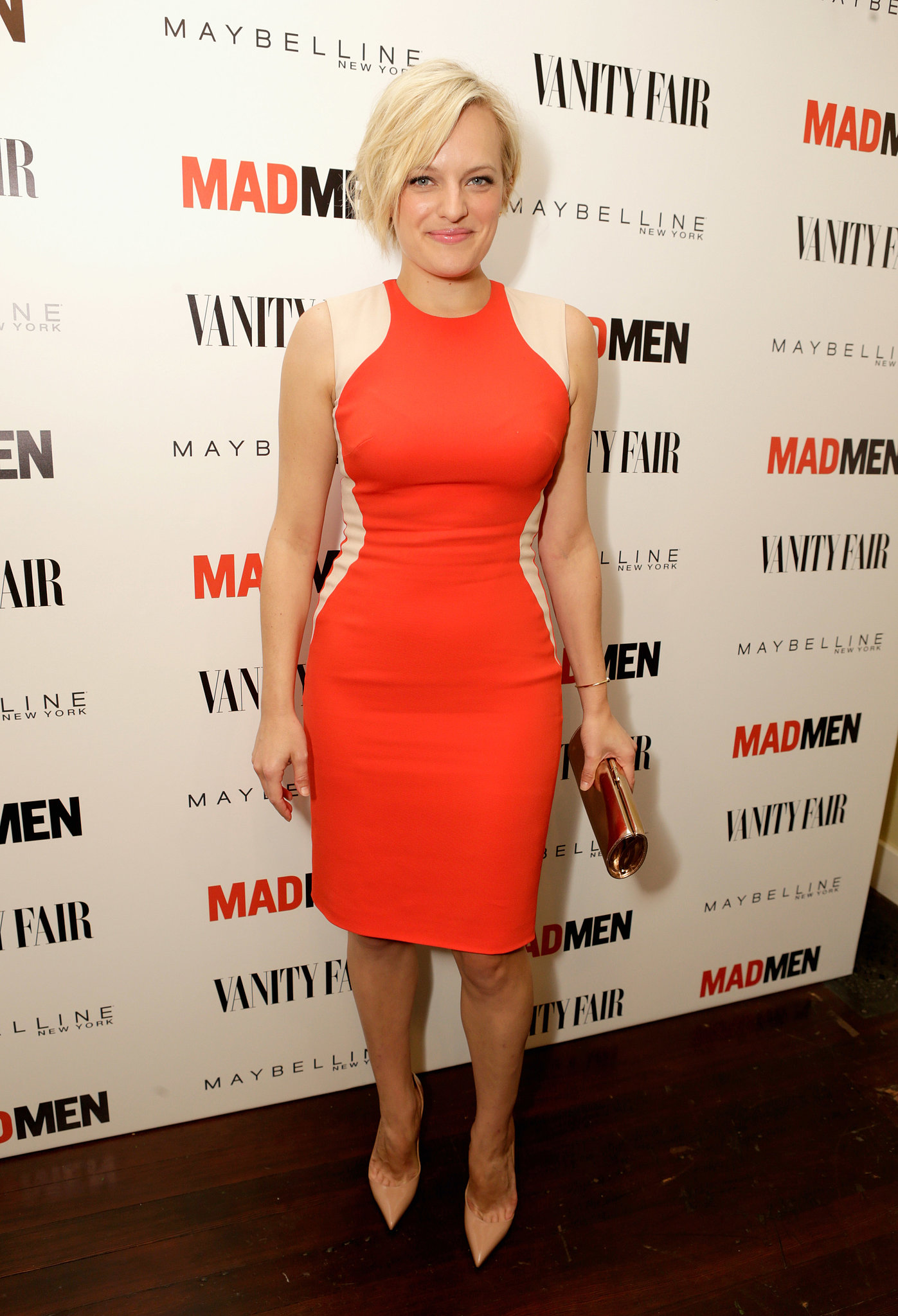 Elisabeth Moss put her curves front and center in a formfitting colorblock dress and pointy pumps at the Vanity Fair and Maybelline pre-Emmys party in honor of Mad Men.