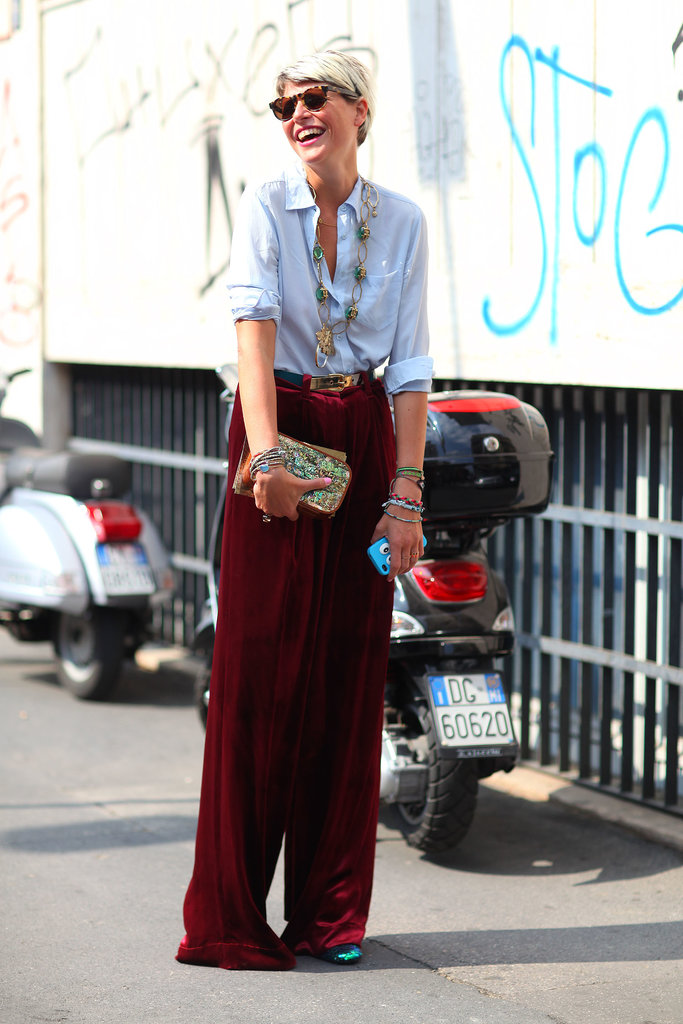 A classic button-down and wide-leg pants get brightened up with a smile.