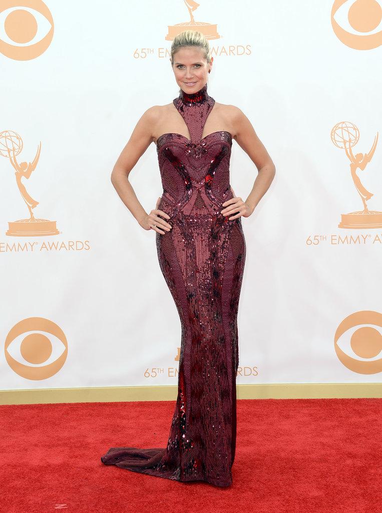 The unique neckline on Heidi Klum's Atelier Versace dress caught our eye first. Her sparkle came courtesy of Lorraine Schwartz gems.