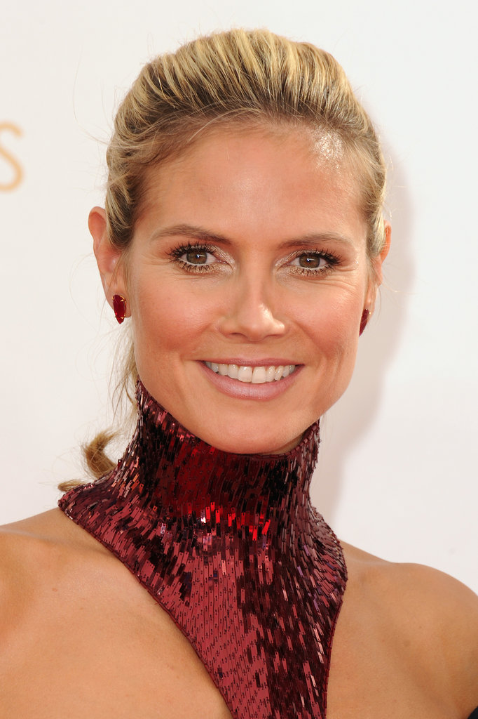 Heidi Klum is obviously an old pro at this red carpet thing, wearing a sleek ponytail and a simple makeup palette (leaving the real excitement to her Versace dress).