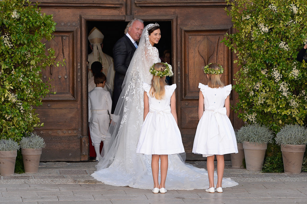 The flower girls wore white, walking behind the bride for the ceremony.