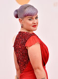 Kelly Osbourne pulled her purple hair into a simple chignon, her blunt bangs swept to the side. Her makeup was highlighted by ruby-red lipstick to match her crimson gown.