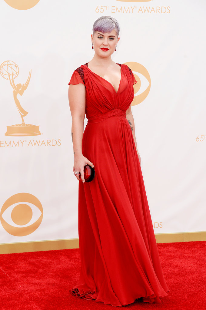 Kelly Osbourne stepped out in a plunging, scarlet red, Grecian-inspired gown by Jenny Packham and a matching jewel-toned clutch.