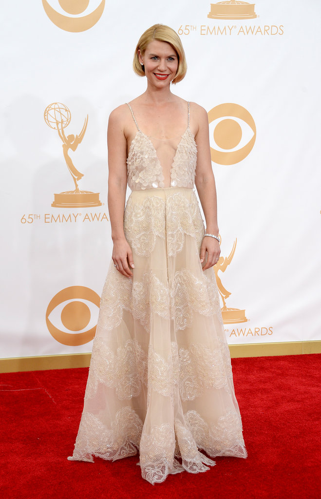 Homeland actress and now triple Emmy Award Winner Claire Danes didn't disappoint on the red carpet, looking every bit the leading lady in a plunging Armani Prive dress, Neil Lane jeweller, custom Christian Louboutin shoes and a Tods clutch.