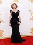 For the Emmys, Mad Men's Christina Hendricks turned to Christian Siriano to create her black gown — with lace detailing that hugged every curve of her signature figure. Art-deco-inspired jewels from Lorraine Schwartz and an Edie Parker clutch added colour to her black dress while accessorizing her outfit with sparkle.