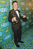 A suited-up Stephen Colbert showed off his two Emmys at the HBO afterparty.