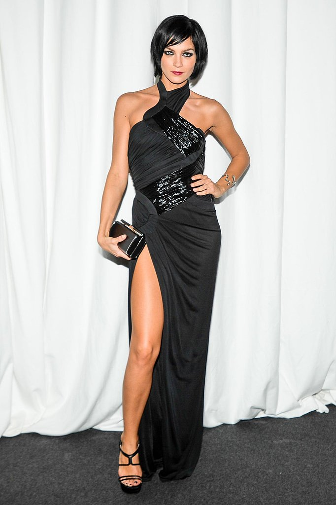 Leigh Lezark showed some leg in a sexy black gown at amfAR's Milan event.