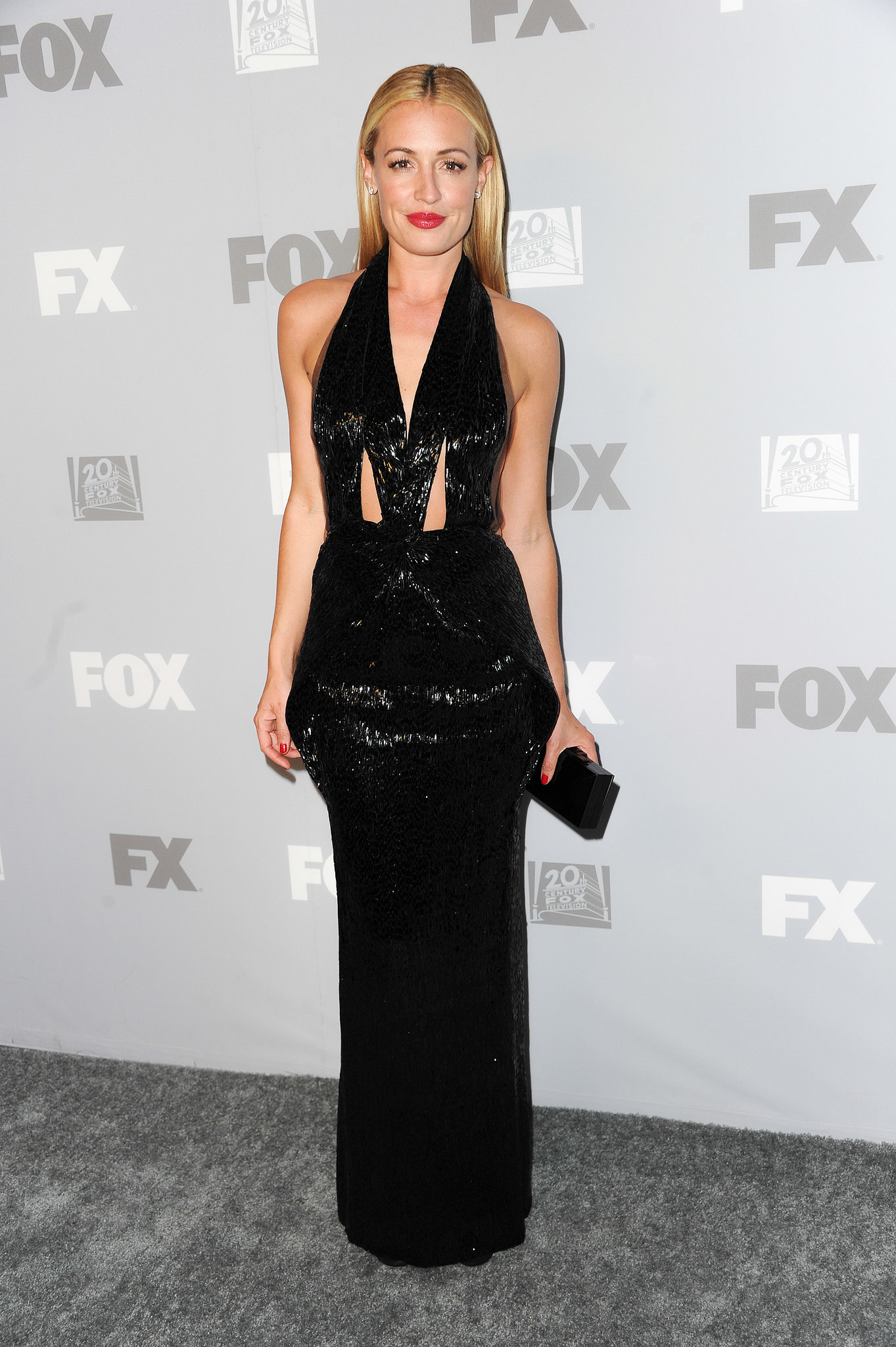 Between the sequins and the cutouts, Cat Deeley's black halter gown at the Fox afterparty was simply dazzling. She finished with Jimmy Choo sandal