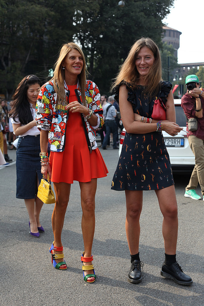 Anna Dello Russo was rainbow-bright perfection, while her showgoing companion kept it cool in a printed dress and tough-girl footwear.
