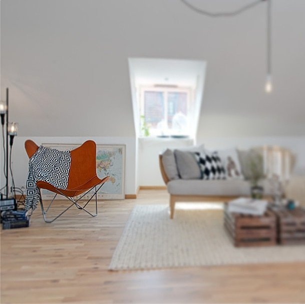 We love how this orange butterfly chair offers a pop of color in an otherwise monochromatic room.  Source: Instagram user interiorarts