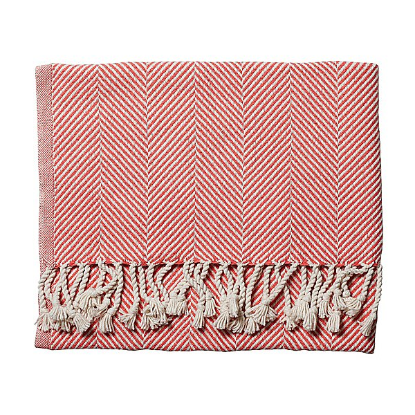 This Herringbone Throw ($250) is just the right amount of preppy. The red and white pattern would look great on a leather sofa.