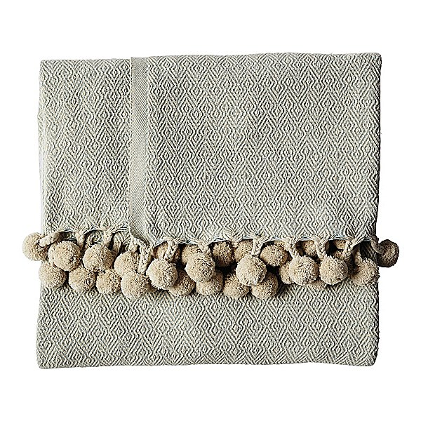 We are bonkers for anything with a pom-pom, and this cotton throw ($128) is no exception!