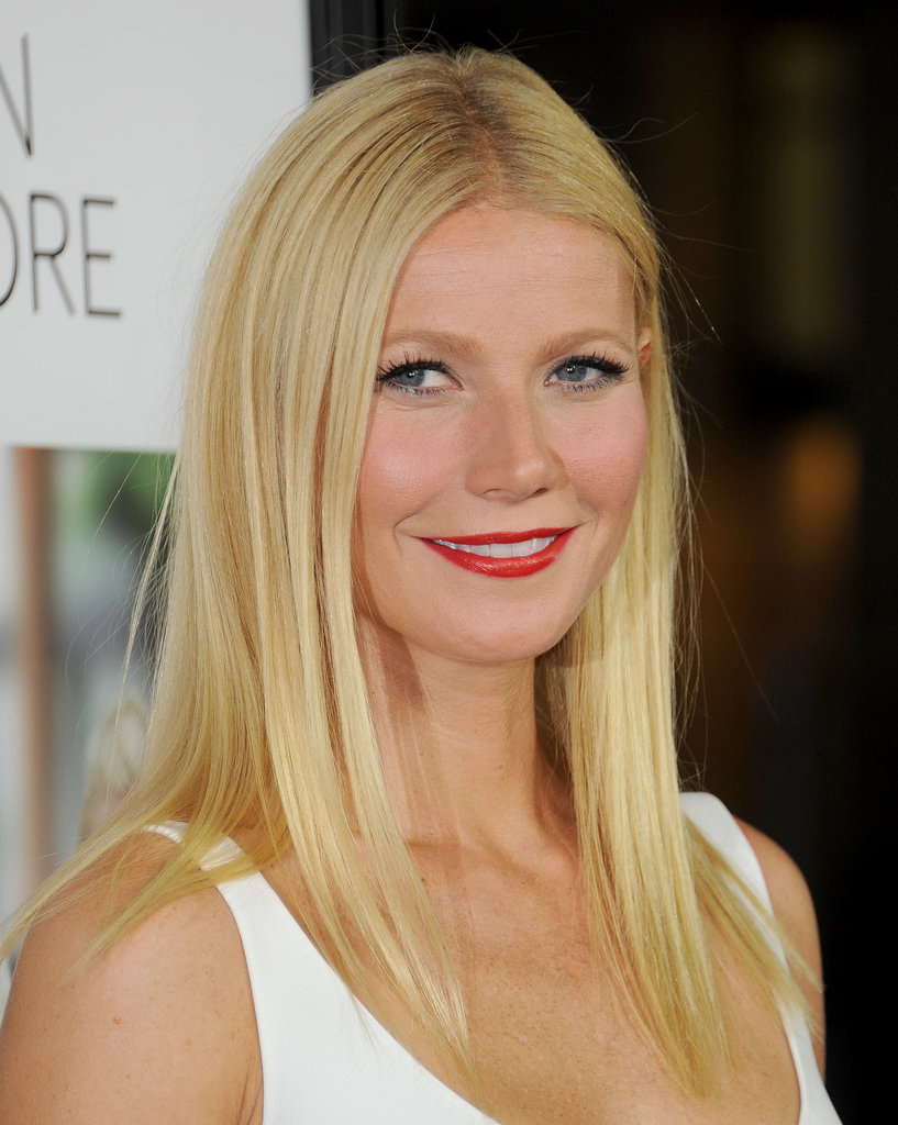 Gwyneth elevated her glossy straight hair with black liner and a red lip while walking the Thanks For Sharing premiere red carpet.