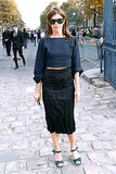 Carine Roitfeld hit the street in a slim midi skirt at Paris Fashion Week for Balenciaga.