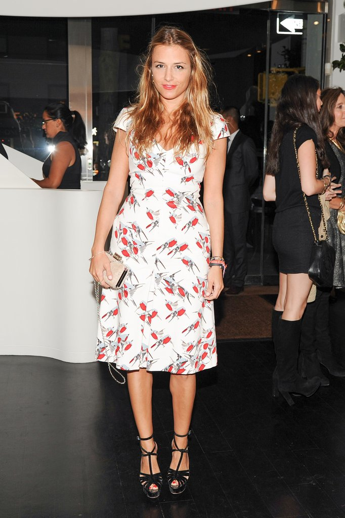 At Carolina Herrera's New York boutique, Charlotte Ronson paired her sweet dress with strappy sandals.