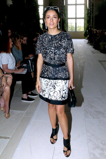 Salma Hayek's black-and-white printed ensemble coordinated perfectly with her flashy sunglasses and bad-girl booties front row at Balenciaga.