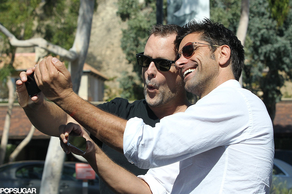 Dave Coulier and John Stamos snapped selfies.