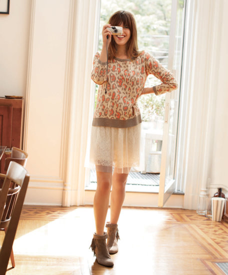 "On attaining the Parisian chic style, Garance said, ""A little pair of boots will make a dress look more feminine sometimes than pairing it with heels. It's about finding that balance."" Boxy Leo Sweater ($69) and Lace Tulle Skirt ($59) Source: Macy's"