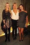 Gwyneth Paltrow was flanked by her model friends Claudia Schiffer and Natalia Vodianova at a Fashion's Night Out event at Stella McCartney's London store in September 2010.