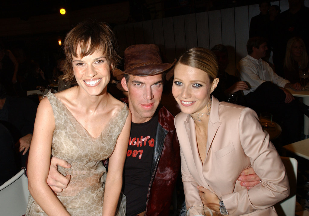 Gwyneth Paltrow cuddled up with Hilary Swank and late makeup artist Kevyn Aucoin at the VH1/Vogue Fashion Awards in October 2001.