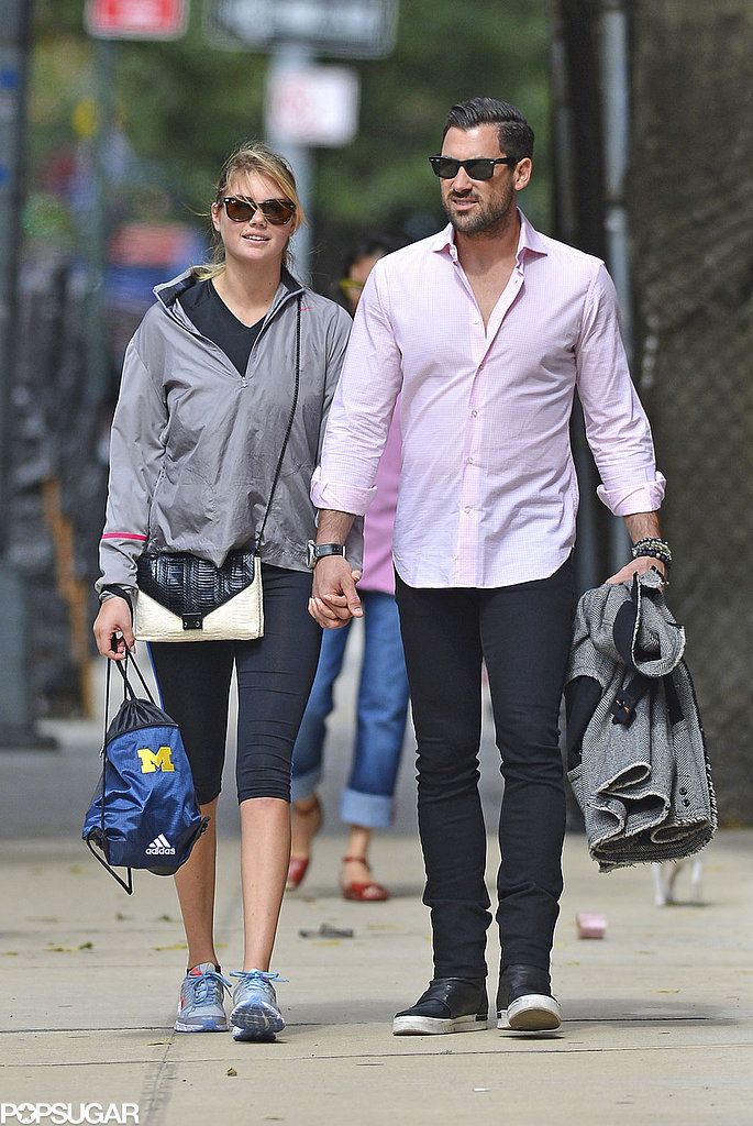 Kate Upton and Maksim Chmerkovskiy held hands as they walked in NYC on Thursday.