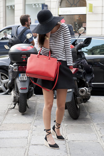 Taking the Parisian dress code to heart in a striped shirt, pop of red, and pair of espadrilles.