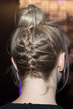 Julianne's bun from the back showed off a french braid for a touch of unexpected fun.