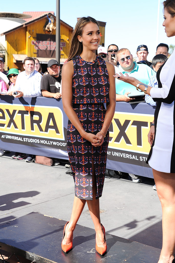While being interviewed for Extra in LA, Jessica Alba earned her time in the spotlight in a printed crop top and matching pencil skirt, both by Tanya Taylor. The extra pop of color via her orange pumps was also perfect. She finished with earrings by Rona Pfeiffer and a ring by EF Collection.