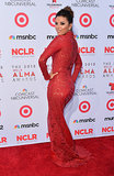 Eva Longoria wore a fiery crimson dress on the red carpet.