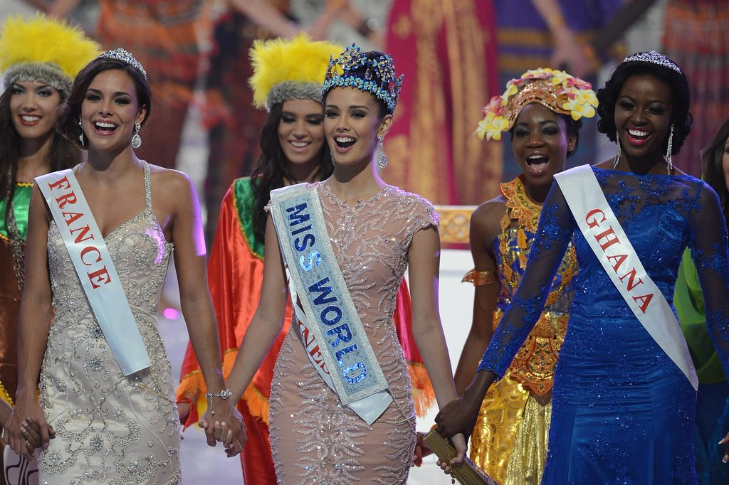 The three finalists linked up at the end of the pageant.