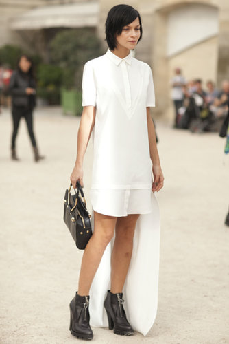 A simple white dress anchored with tough-girl add-ons.