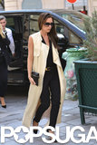 Victoria Beckham rocked a floor-length sleeveless trench coat after her handbag presentation.