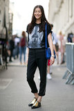 Liu Wen styles up her look with snazzy kicks.