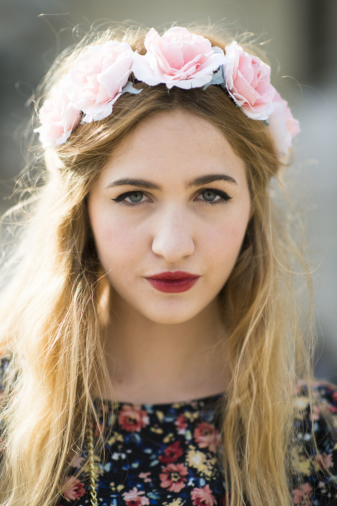Elisa Baudoin's flower crown and moody lipstick combination is simply gorgeous. 