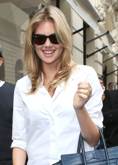 Kate Upton smiled for photographers.