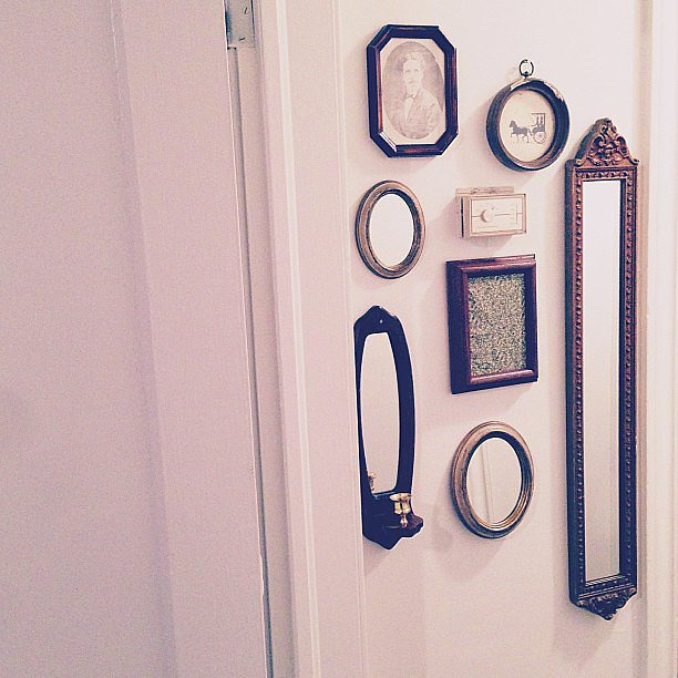 Assemble a mix of small mirrors in an awkwardly narrow nook, like the wall space between two doors.    Source: Instagram user morganwren22