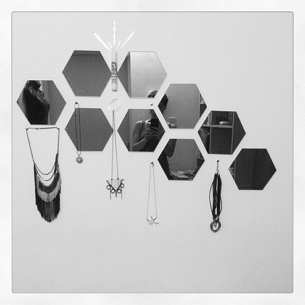 Small, geometric-cut mirrors create a dazzling backdrop for necklaces. Source: Instagram user danikabrooke