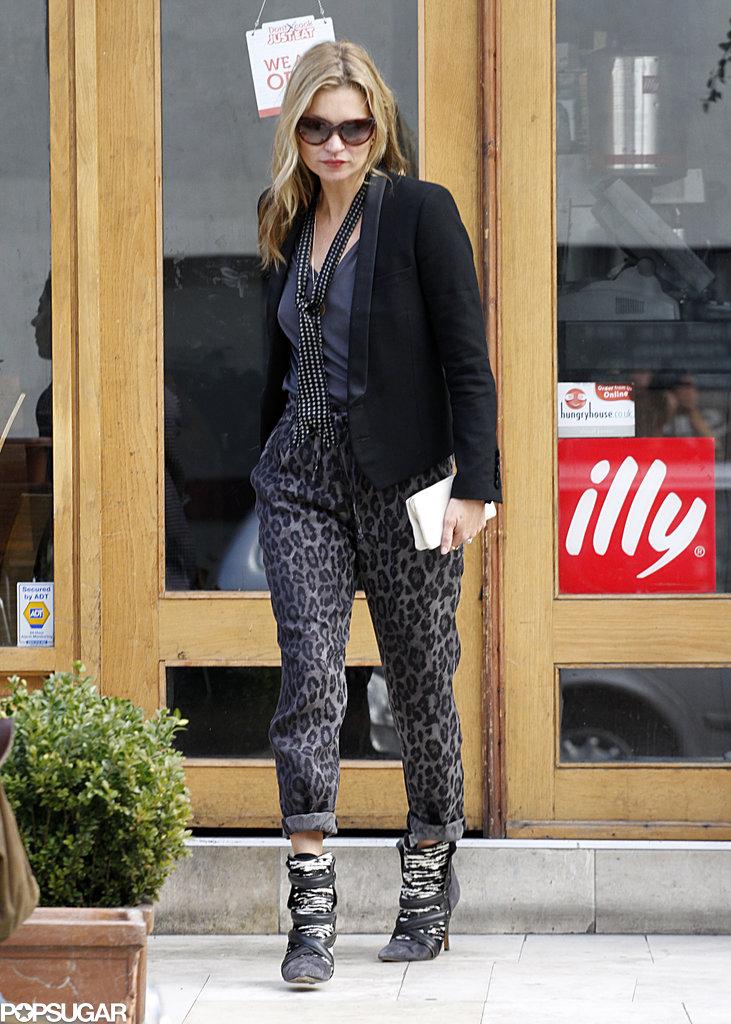 Kate Moss left a restaurant in London.