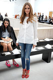 Olivia Palermo kept it simple in the front row of Veronique Leroy in a classic white button-down, skinny AG denim, and red Aquazurra heels.