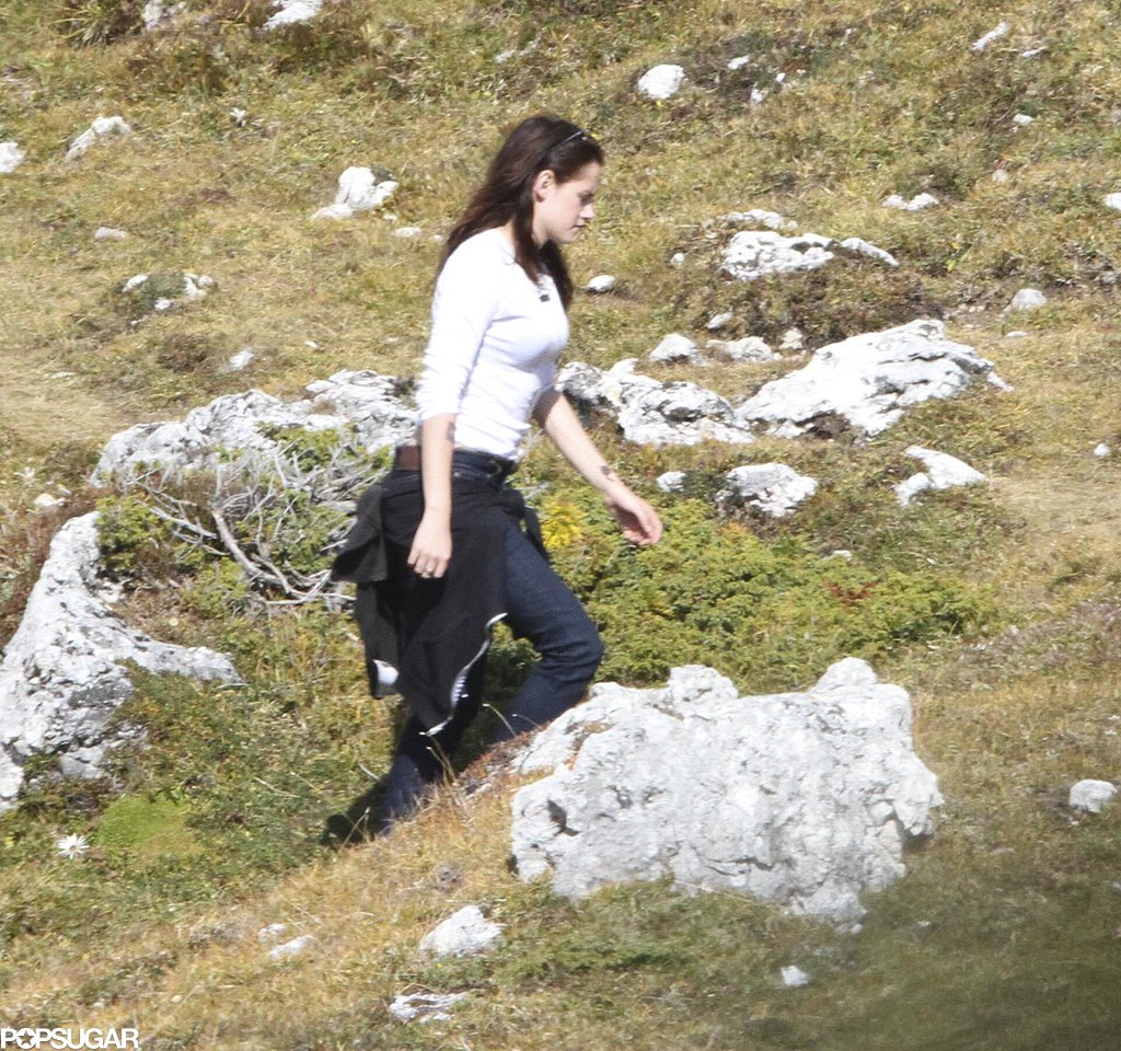 Kristen Stewart filmed a scene on a grassy hill.