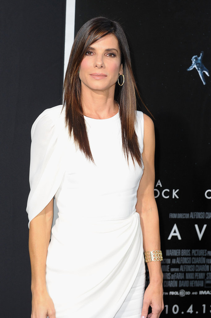 Sandra Bullock wore a beautiful white draped dress at the NYC premiere of Gravity.