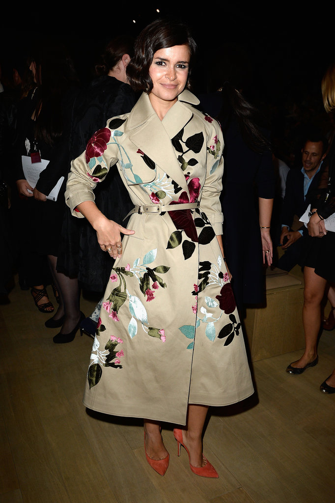 Miroslava Duma took in the Valentino runway in an embellished trench.