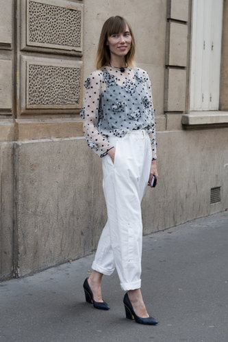 Anya Ziourova knows that adding a delicate blouse to easy trousers is a flawless outfit formula.